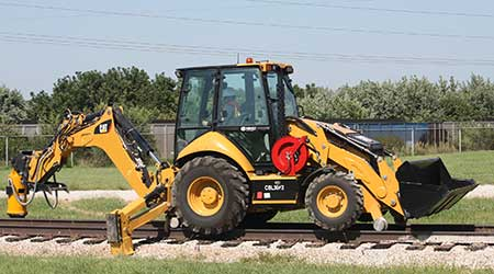 NMC Railway: Hi-Rail Backhoe Loader